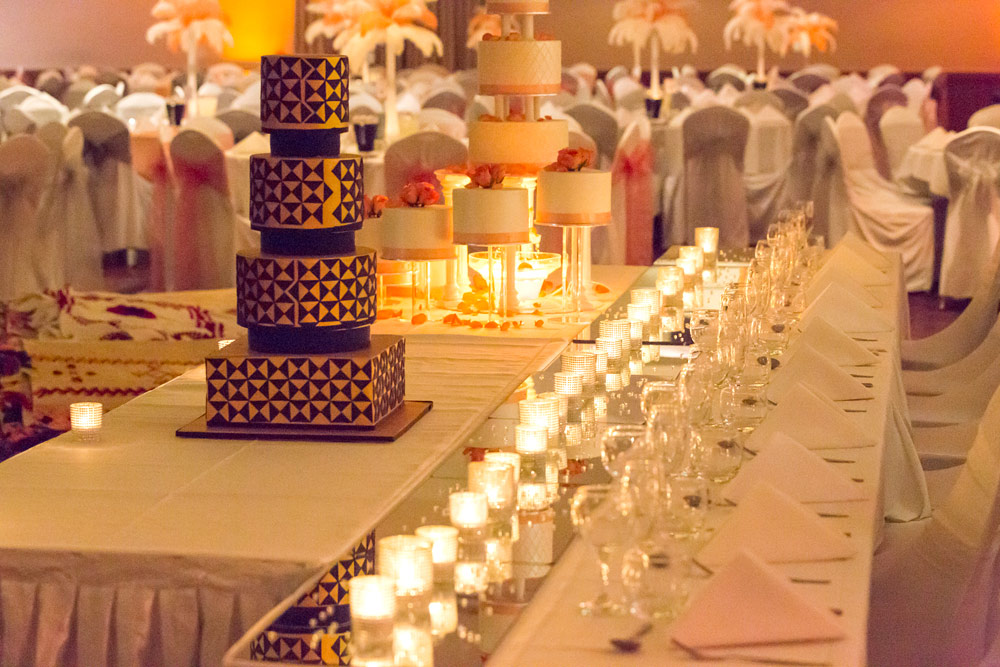 Wedding cake, candles and glasses