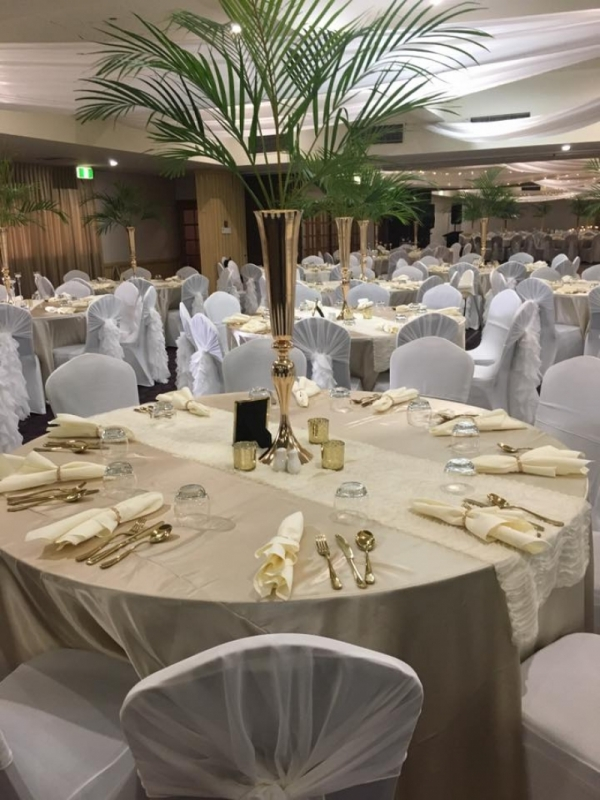 Wedding reception table, chairs and palm fronds